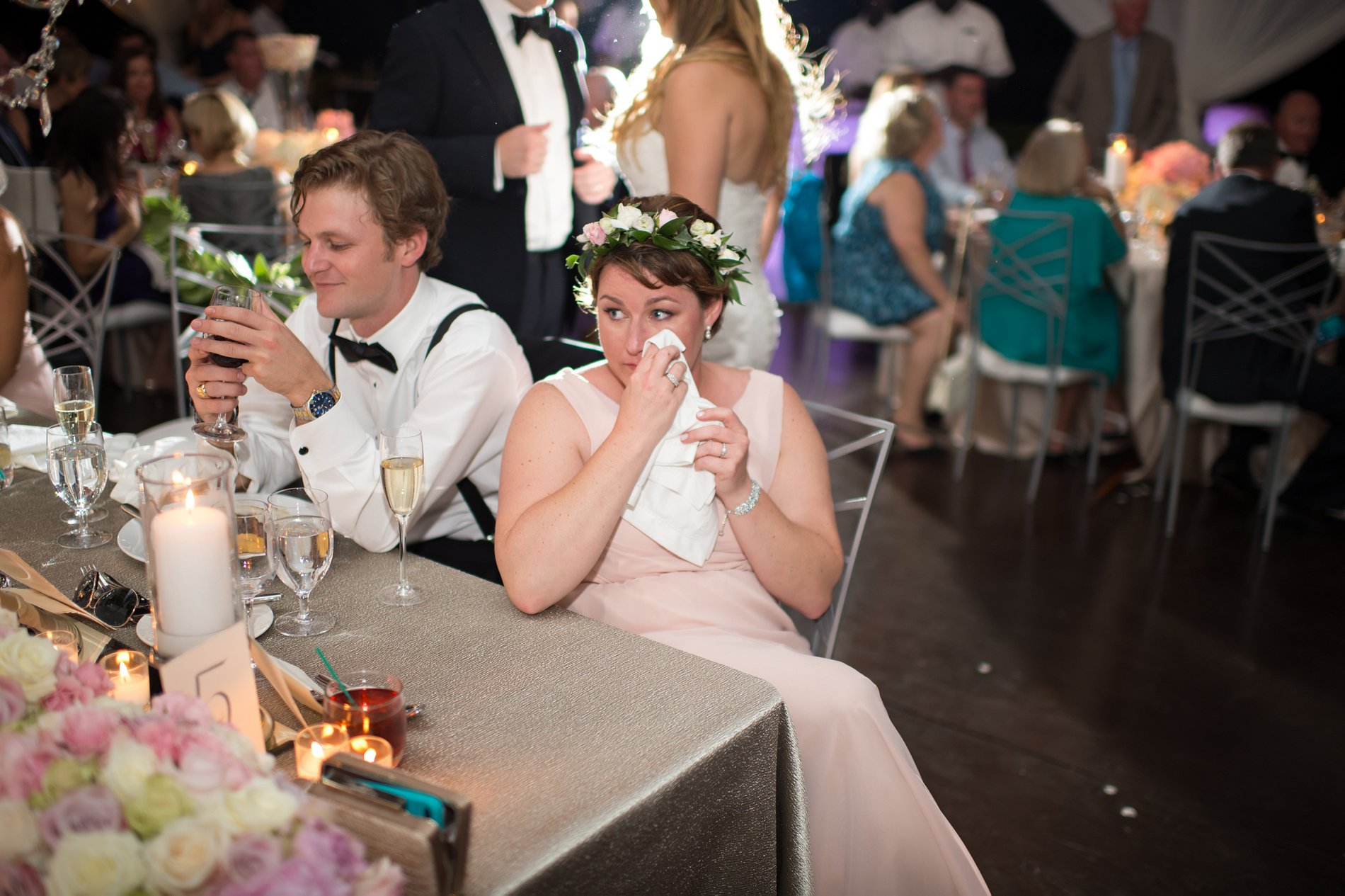 Bridal party crying at a wedding